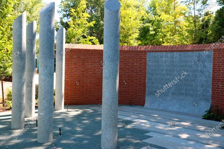 This June 24, 2021 photo shows a memorial in Annapolis, Md., that is being dedicated, to the five people who were killed in a mass shooting at the Capital Gazette newspaper three years earlier. Represented by the five pillars, Rebecca Smith, Wendi Winters, Gerald Fischman, Rob Hiaasen, and John McNamara died in the shooting. The panel behind the pillars shows the First Amendment