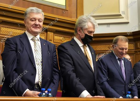 Former Ukrainian Presidents, left to right Petro Poroshenko, Viktor Yushchenko, Leonid Kuchma, attend a ceremony on the occasion of the 25th anniversary of the Ukrainian Constitution in the parliament session hall in Kyiv, Ukraine, . Ukrainians mark the Constitution Day