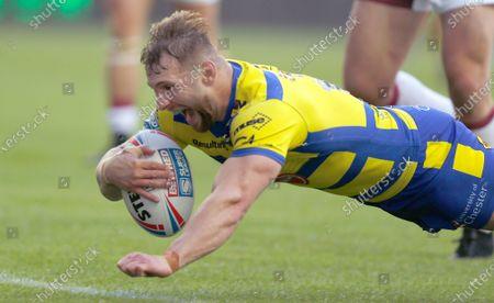 Matt Davis of Warrington Wolves lands the 3rd try