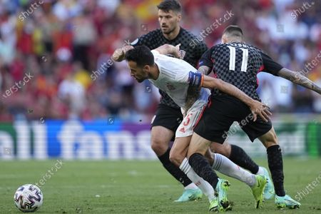 Croatias Marcelo Brozovic, right, and Spains Sergio Busquets, center, during the UEFA EURO 2020 round of 16 soccer match between Croatia and Spain in Copenhagen, Denmark, 28 June 202