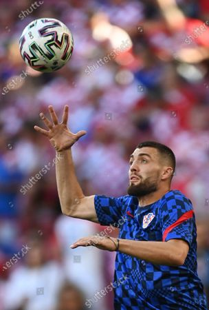 Croatia's Mateo Kovacic jumps for the ball during the warm-up prior to the Euro 2020 soccer championship round of 16 match between Croatia and Spain at the Parken Stadium in Copenhagen