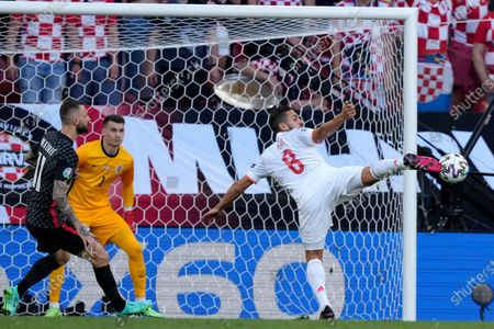 Spain's Koke reaches for the ball in front of Croatia's goalkeeper Dominik Livakovic and Croatia's Marcelo Brozovic, left, during the Euro 2020 soccer championship round of 16 match between Croatia and Spain at Parken stadium in Copenhagen, Denmark