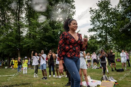 Protesters at Nelson Mandela Parc in Amsterdam for the Black Pride Protest , in Amsterdam, Netherlands, on June 28, 2021. A couple of hundred people gathered at the Nelson Mandela Parc in the South East of Amsterdam, the Bijlmer. A district known for having a large group of black inhabitants. There was held a Black Pride Protest. The demonstrators believe that they must emphazise the struggles of people of color in the lhbti-community.