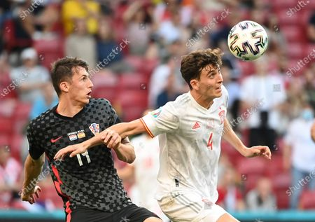 Spain's Pau Torres, right, and Croatia's Marcelo Brozovic challenge for the ball during the Euro 2020 soccer championship round of 16 match between Croatia and Spain at Parken stadium in Copenhagen, Denmark
