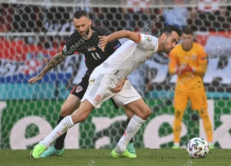 Spain's Sergio Busquets, right, and Croatia's Marcelo Brozovic challenge for the ball during the Euro 2020 soccer championship round of 16 match between Croatia and Spain at Parken stadium in Copenhagen, Denmark