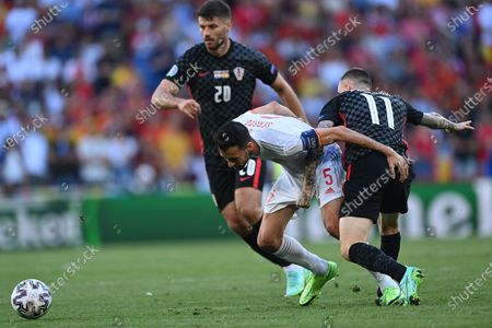 Sergio Busquets (C) of Spain in action against Marcelo Brozovic (R) of Croatia during the UEFA EURO 2020 round of 16 soccer match between Croatia and Spain in Copenhagen, Denmark, 28 June 2021.