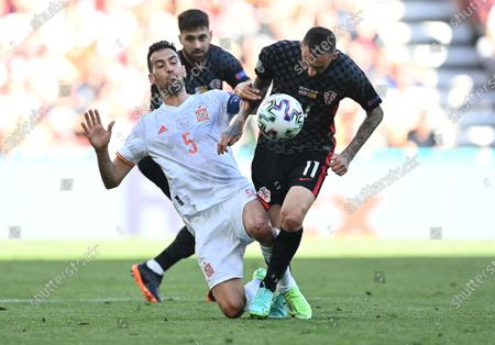 Sergio Busquets (L) of Spain in action against Marcelo Brozovic of Croatia during the UEFA EURO 2020 round of 16 soccer match between Croatia and Spain in Copenhagen, Denmark, 28 June 2021.