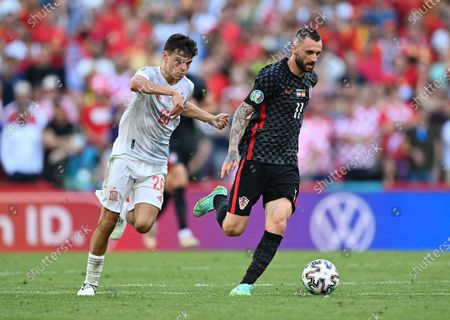 Pedri (L) of Spain in action against Marcelo Brozovic of Croatia during the UEFA EURO 2020 round of 16 soccer match between Croatia and Spain in Copenhagen, Denmark, 28 June 2021.