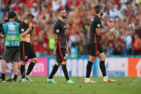 Marcelo Brozovic (C) of Croatia and teammates react after the UEFA EURO 2020 round of 16 soccer match between Croatia and Spain in Copenhagen, Denmark, 28 June 2021.
