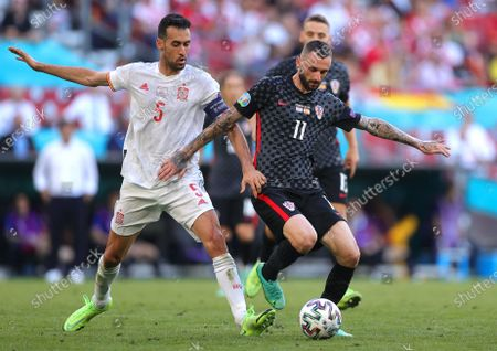 Marcelo Brozovic (R) of Croatia in action against Sergio Busquets (L) of Spain during the UEFA EURO 2020 round of 16 soccer match between Croatia and Spain in Copenhagen, Denmark, 28 June 2021.