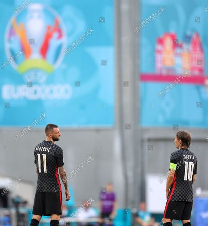 Croatian players Marcelo Brozovic (L) and  Luka Modric (R) react during the UEFA EURO 2020 round of 16 soccer match between Croatia and Spain in Copenhagen, Denmark, 28 June 2021.