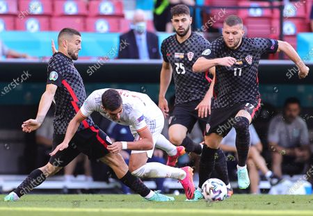 Ferran Torres (C) of Spain in action against Croatian players Mateo Kovacic (L) and Ante Rebic (R) during the UEFA EURO 2020 round of 16 soccer match between Croatia and Spain in Copenhagen, Denmark, 28 June 2021.