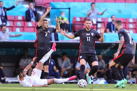 Ferran Torres (L) of Spain and Croatian players Mateo Kovacic (2-L) and Ante Rebic (2-R) react during the UEFA EURO 2020 round of 16 soccer match between Croatia and Spain in Copenhagen, Denmark, 28 June 2021.
