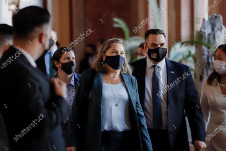Stock Image of US Undersecretary of State, Victoria Nuland (C), leaves along with her work team after a meeting with the President of Paraguay, Mario Abdo Benitez (out of frame), at the Government Palace in Asuncion, Paraguay, 28 June 2021. Nuland arrived at the Government Palace with a large delegation, including Acting Under Secretary of State for the US Office of Western Hemisphere Affairs, Julie Chung, and Deputy Under Secretary of Defense for the Western Hemisphere, Daniel Erikson. Nuland plans to hold a private meeting with Foreign Minister Euclides Acevedo late and then proceed to a bilateral dialogue, after which a press conference will be held.