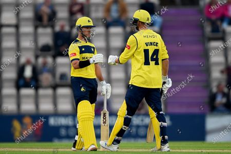 D'Arcy Short (left) and James Vince during the Vitality T20 Blast match between Hampshire Hawks and Surrey at The Ageas Bowl, Southampton