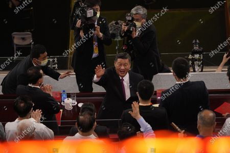 Chinese President Xi Jinping waves as he attends a gala show ahead of the 100th anniversary of the founding of the Chinese Communist Party in Beijing, . China is marking the centenary of its ruling Communist Party this week by heralding what it says is its growing influence abroad, along with success in battling corruption at home. Party officials on Monday heaped praise on President Xi Jinping, who has established himself as China's most powerful leader since Mao Zedong, and has eliminated any limits on his term in office