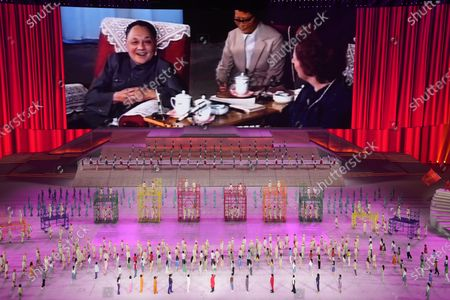 Late Chinese leader Deng Xiaoping is displayed on screen during a gala show ahead of the 100th anniversary of the founding of the Chinese Communist Party in Beijing on . The communists have ruled China single-handedly for more than 70 years since Mao Zedong led them to power in 1949. After his death in 1976, they started a sharp turn under then-leader Deng, embracing a market economy that has transformed what was a poor country into an economic power