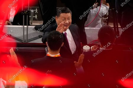 Chinese President Xi Jinping waves as he attends a gala show ahead of the 100th anniversary of the founding of the Chinese Communist Party in Beijing on . China is marking the centenary of its ruling Communist Party this week by heralding what it says is its growing influence abroad, along with success in battling corruption at home. Party officials on Monday heaped praise on President Xi Jinping, who has established himself as China's most powerful leader since Mao Zedong, and has eliminated any limits on his term in office