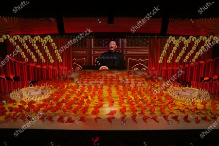 Chinese President Xi Jinping is displayed on a screen as performers dance at a gala show ahead of the 100th anniversary of the founding of the Chinese Communist Party in Beijing on . China is marking the centenary of its ruling Communist Party this week by heralding what it says is its growing influence abroad, along with success in battling corruption at home. Party officials on Monday heaped praise on President Xi Jinping, who has established himself as China's most powerful leader since Mao Zedong, and has eliminated any limits on his term in office