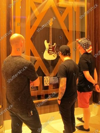 Visitors look at a guitar once owned by Jimi Hendrix in the Hard Rock casino in Atlantic City N.J. on . Hard Rock last year finished second only to the Borgata in terms of money won from in-person gamblers
