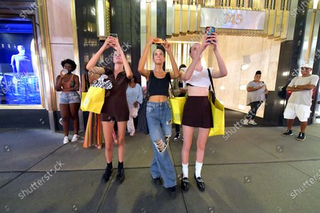 Marc Jacobs models stop and watch the Marc Jacobs show projection
