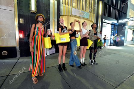 Stock Picture of Marc Jacobs models stop and watch the Marc Jacobs show projection