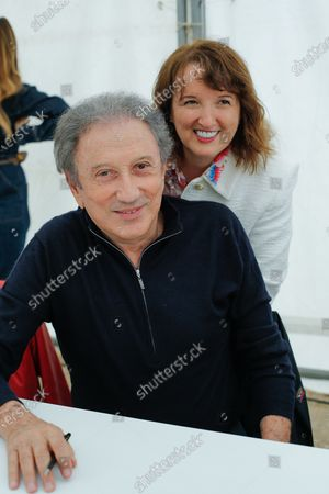 """Michel Drucker and Anne Roumanoff at the fifth festival """"Des Livres Des Stars"""""""