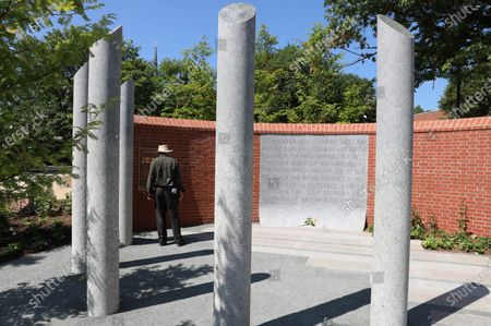 Visitor stands by a new memorial dedicated to the five people who died in the mass shooting at the Capital Gazette three years ago, in Annapolis, Md. The five pillars honor Rebecca Smith, Wendi Winters, Gerald Fischman, Rob Hiaasen, and John McNamara who died in the attack. The memorial includes the First Amendment in a panel