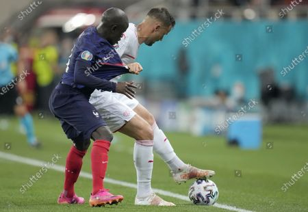 France's N'Golo Kante, left, and Switzerland's Haris Seferovic challenge for the ball during the Euro 2020 soccer championship round of 16 match between France and Switzerland at the National Arena stadium in Bucharest, Romania