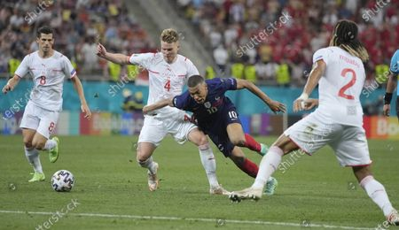 France's Kylian Mbappe, second right, and Switzerland's Nico Elvedi challenge for the ball during the Euro 2020 soccer championship round of 16 match between France and Switzerland at the National Arena stadium in Bucharest, Romania