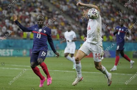 France's N'Golo Kante, left, and Switzerland's Steven Zuber challenge for the ball during the Euro 2020 soccer championship round of 16 match between France and Switzerland at the National Arena stadium in Bucharest, Romania