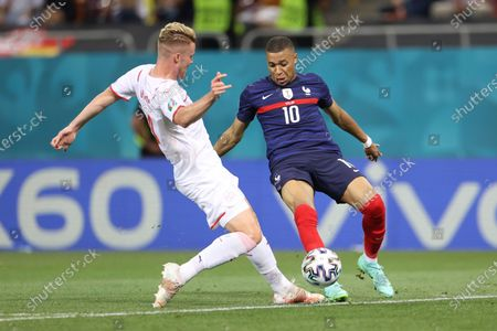 France's Kylian Mbappe, right, fights for the ball with Switzerland's Nico Elvedi during the Euro 2020 soccer championship round of 16 match between France and Switzerland at the National Arena stadium, in Bucharest, Romania