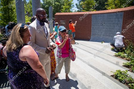 People tour the Guardians of the First Amendment Memorial following the dedication ceremony in Annapolis, Maryland, USA, on 28 June 2021. On 28 June 2018 five journalists and staff of the Capitol Gazette, Gerald Fischman, Rob Hiaasen, John MCNamara, Rebecca Smith and Wendi Winters, were killed during a mass shooting incident in their office.