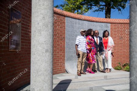 People have their picture taken prior to the dedication ceremony for the Guardians of the First Amendment Memorial in Annapolis, Maryland, USA, on 28 June 2021. On 28 June 2018 five journalists and staff of the Capitol Gazette, Gerald Fischman, Rob Hiaasen, John MCNamara, Rebecca Smith and Wendi Winters, were killed during a mass shooting incident in their office.