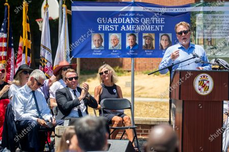 Former Editor of the Capitol Gazette, Rick Hutzell (R) delivers remarks during the dedication ceremony for the Guardians of the First Amendment Memorial in Annapolis, Maryland, USA, 28 June 2021. On 28 June 2018 five journalists and staff of the Capitol Gazette, Gerald Fischman, Rob Hiaasen, John MCNamara, Rebecca Smith and Wendi Winters, were killed during a mass shooting incident in their office.
