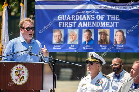 Former Editor of the Capitol Gazette, Rick Hutzell (L) delivers remarks during the dedication ceremony for the Guardians of the First Amendment Memorial in Annapolis, Maryland, USA, 28 June 2021. On 28 June 2018 five journalists and staff of the Capitol Gazette, Gerald Fischman, Rob Hiaasen, John MCNamara, Rebecca Smith and Wendi Winters, were killed during a mass shooting incident in their office.