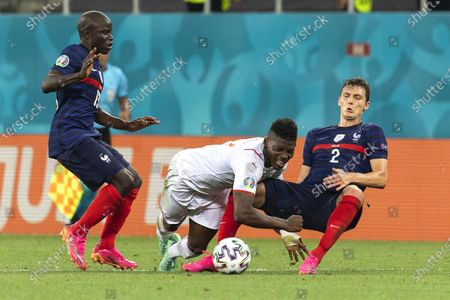 Switzerland's Breel Embolo (C) in action against French players N'Golo Kante (L) and Benjamin Pavard (R) during the UEFA EURO 2020 round of 16 soccer match between France and Switzerland in Bucharest, Romania, 28 June 2021.