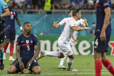 France's Presnel Kimpembe (L) reacts as Switzerland's Mario Gavranovic (front R) celebrates after scoring the 3-3 equalizer during the UEFA EURO 2020 round of 16 soccer match between France and Switzerland in Bucharest, Romania, 28 June 2021.