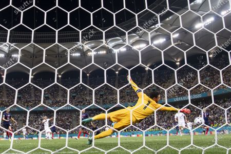Switzerland's Mario Gavranovic (back, 2-L) scores the 3-3 equalizer against France's goalkeeper Hugo Lloris (front) during the UEFA EURO 2020 round of 16 soccer match between France and Switzerland in Bucharest, Romania, 28 June 2021.