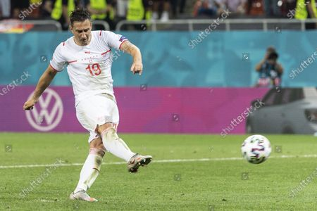 Switzerland's Mario Gavranovic scores during the penalty shootout of the UEFA EURO 2020 round of 16 soccer match between France and Switzerland in Bucharest, Romania, 28 June 2021.