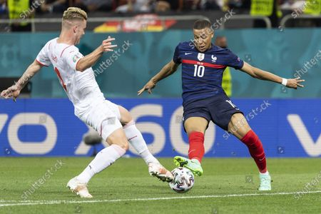 Switzerland's Nico Elvedi (L) in action against France's Kylian Mbappe (R) during the UEFA EURO 2020 round of 16 soccer match between France and Switzerland in Bucharest, Romania, 28 June 2021.