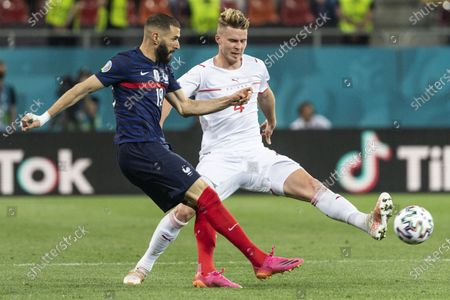 France's Karim Benzema (L) in action against Switzerland's Nico Elvedi (R) during the UEFA EURO 2020 round of 16 soccer match between France and Switzerland in Bucharest, Romania, 28 June 2021.