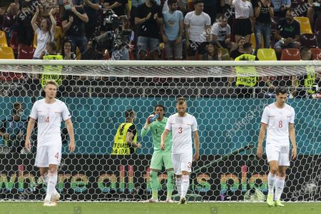 Swiss players (L-R) Nico Elvedi, goalkeeper Yann Sommer, Silvan Widmer, and Remo Freuler react during the UEFA EURO 2020 round of 16 soccer match between France and Switzerland in Bucharest, Romania, 28 June 2021.