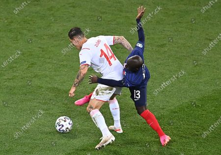 N'Golo Kante (R) of France in action against Steven Zuber of Switzerland during the UEFA EURO 2020 round of 16 soccer match between France and Switzerland in Bucharest, Romania, 28 June 2021.