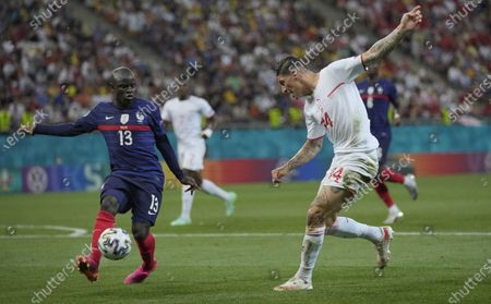 N'Golo Kante (L) of France in action against Steven Zuber of Switzerland during the UEFA EURO 2020 round of 16 soccer match between France and Switzerland in Bucharest, Romania, 28 June 2021.