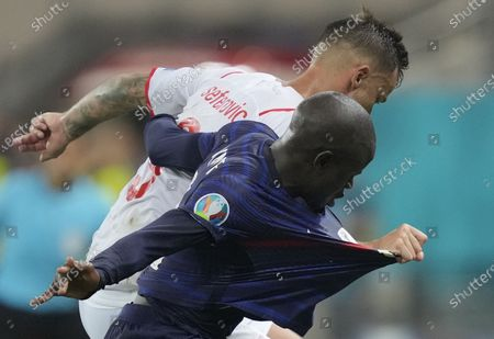 N'Golo Kante of France in action against Haris Seferovic (rear) of Switzerland during the UEFA EURO 2020 round of 16 soccer match between France and Switzerland in Bucharest, Romania, 28 June 2021.