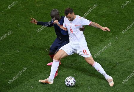 Haris Seferovic (R) of Switzerland in action against N'Golo Kante of France during the UEFA EURO 2020 round of 16 soccer match between France and Switzerland in Bucharest, Romania, 28 June 2021.