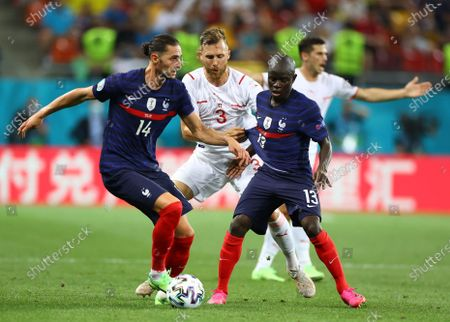 Adrien Rabiot (L) and N'Golo Kante (R) of France in action against Silvan Widmer of Switzerland during the UEFA EURO 2020 round of 16 soccer match between France and Switzerland in Bucharest, Romania, 28 June 2021.