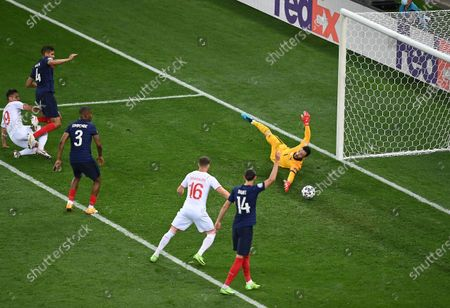 Mario Gavranovic (L) of Switzerland scores a goal that was later disallowed during the UEFA EURO 2020 round of 16 soccer match between France and Switzerland in Bucharest, Romania, 28 June 2021.