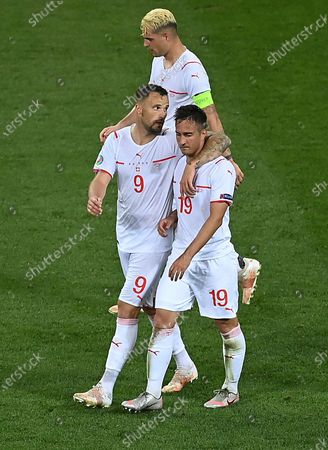 Mario Gavranovic (R) of Switzerland reacts after scoring his team's third goal during the UEFA EURO 2020 round of 16 soccer match between France and Switzerland in Bucharest, Romania, 28 June 2021.